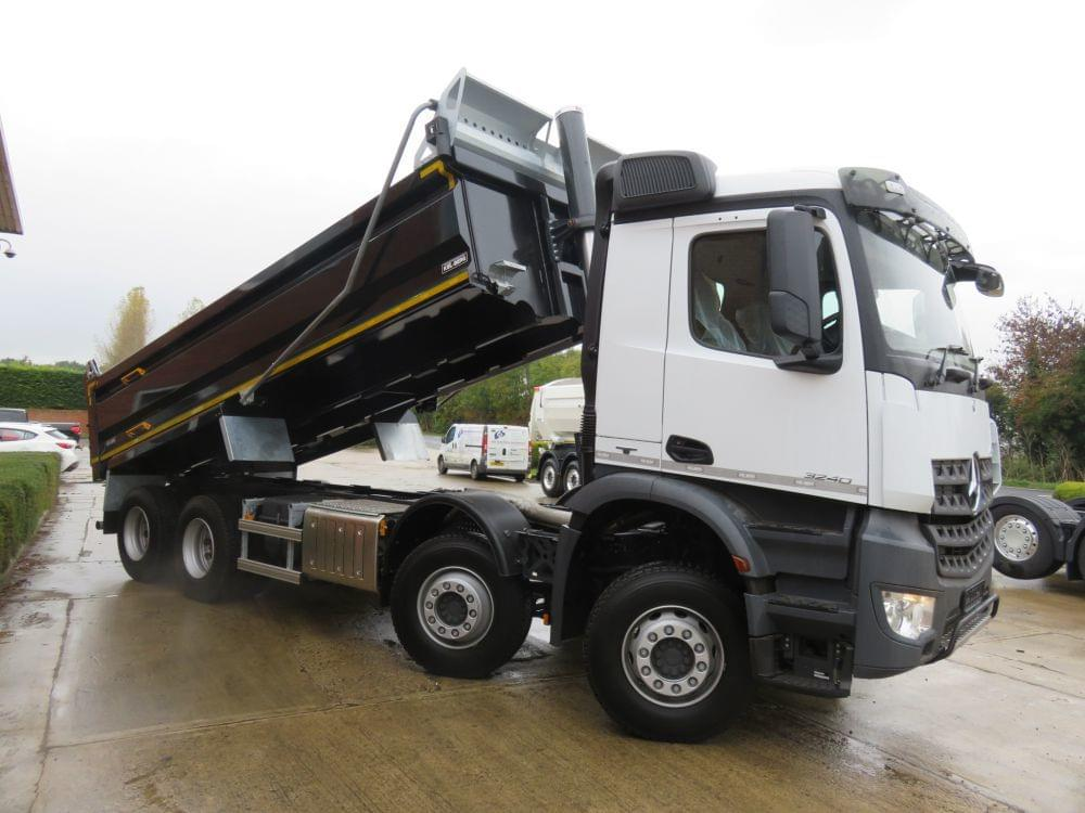 Black Tipper lorry with back up